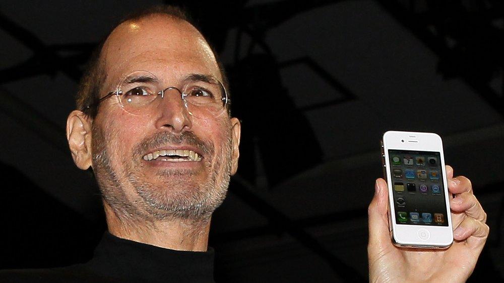 Steve Jobs and an iPhone