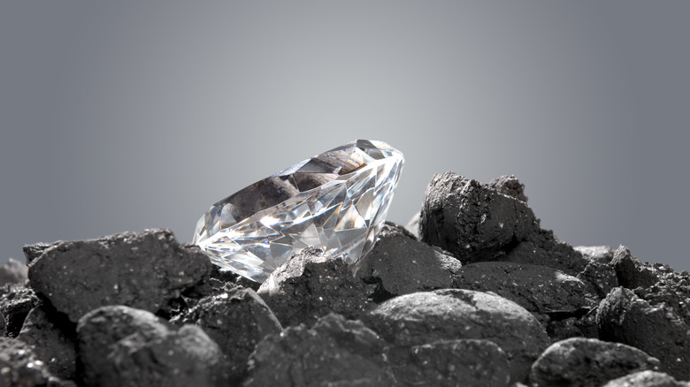 Diamond in pile of coal