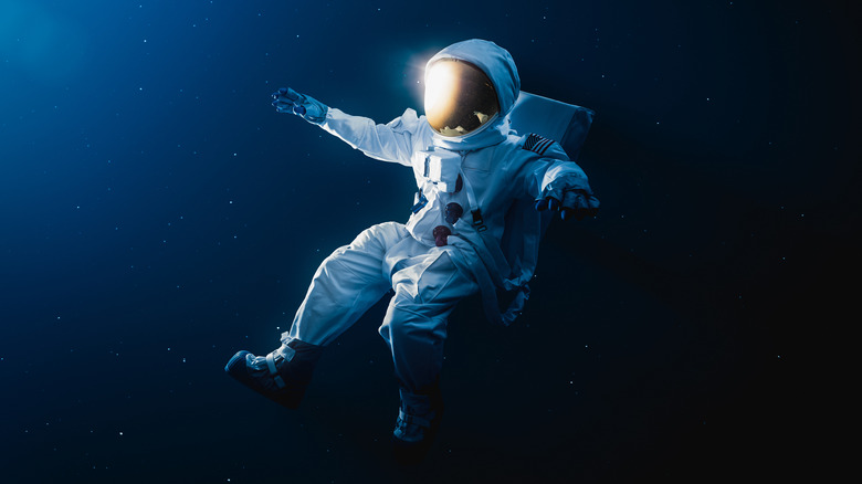 astronaut drifting in outer space