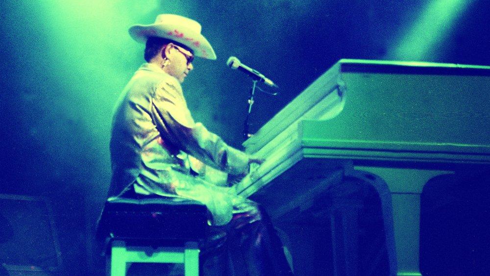 Elton John playing in the 80s