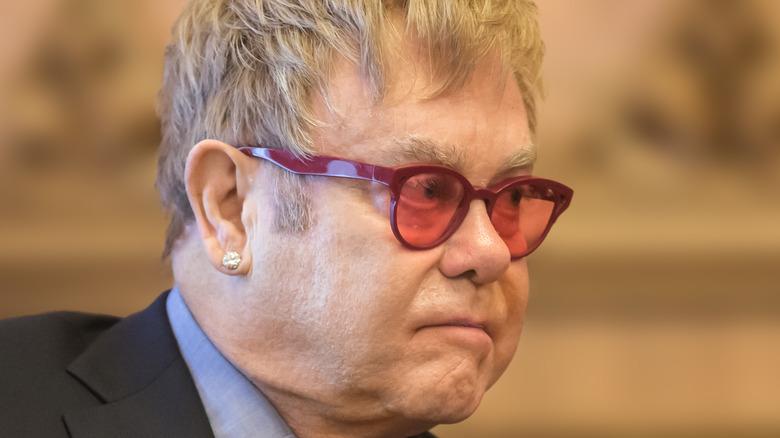 Elton John sitting