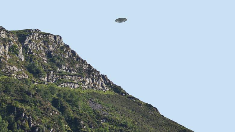 UFO flying over cliffs