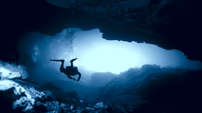 A diver in a cave