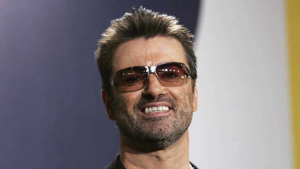 A shot of George Michael smiling