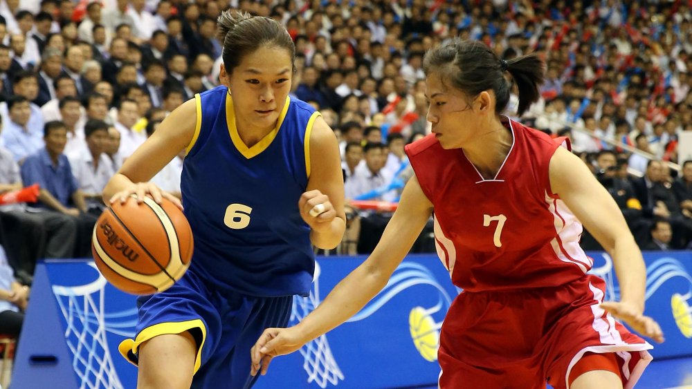 Female North Korean basketball players during a game.