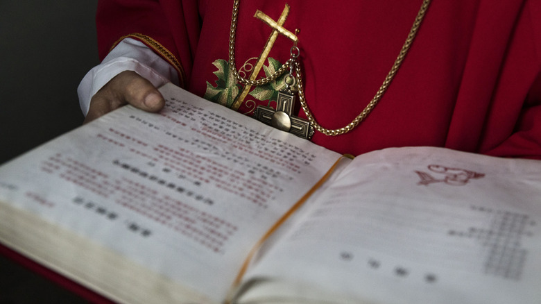 Chinese Catholic deacon with Bible