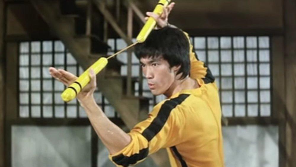 Bruce Lee with nunchucks
