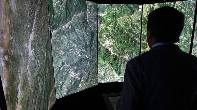 Man viewing Google Earth images