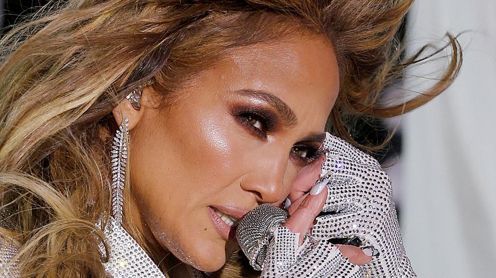 Jennifer Lopez singing into mic