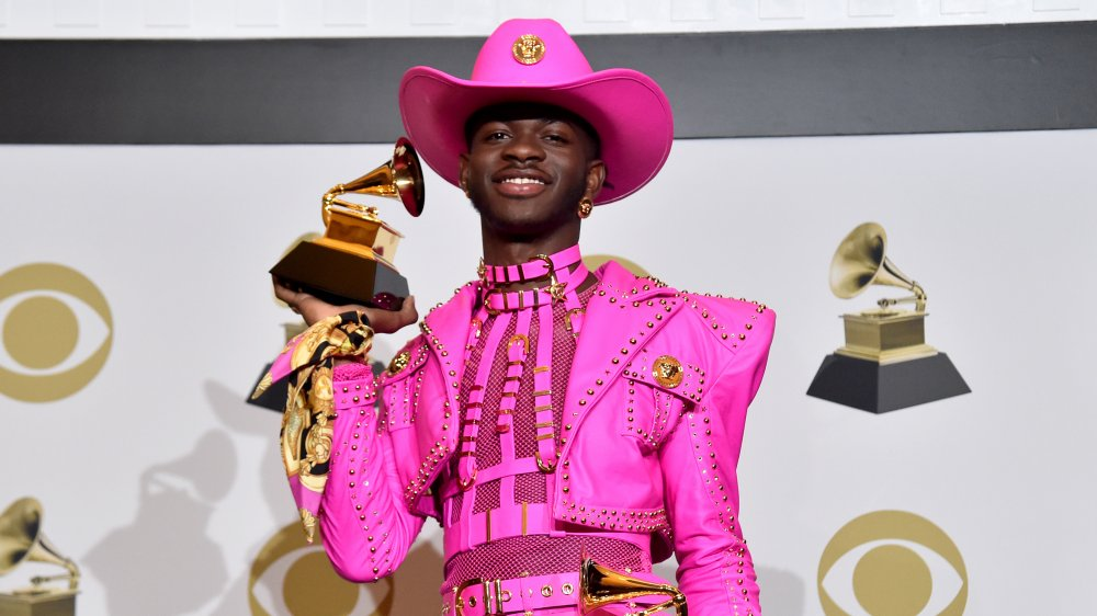 A photograph of Lil Nas X in a pink cowboy uniform from the 2019 Grammys.