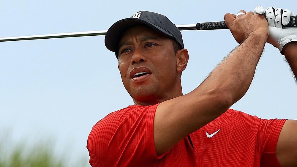 Tiger Woods swings