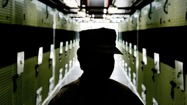 Guantánamo Bay guard walking hallway