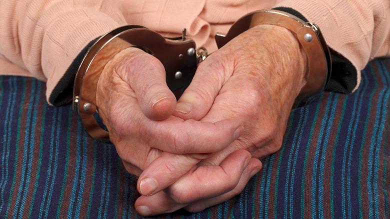 Elderly woman in handcuffs