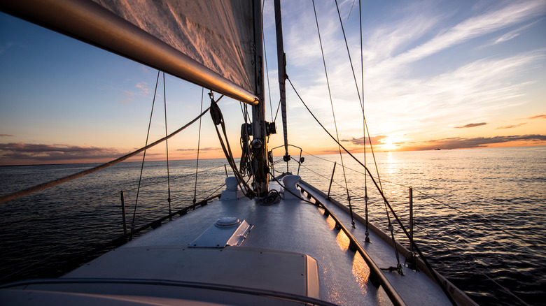 Sloop sailboat view at sunset