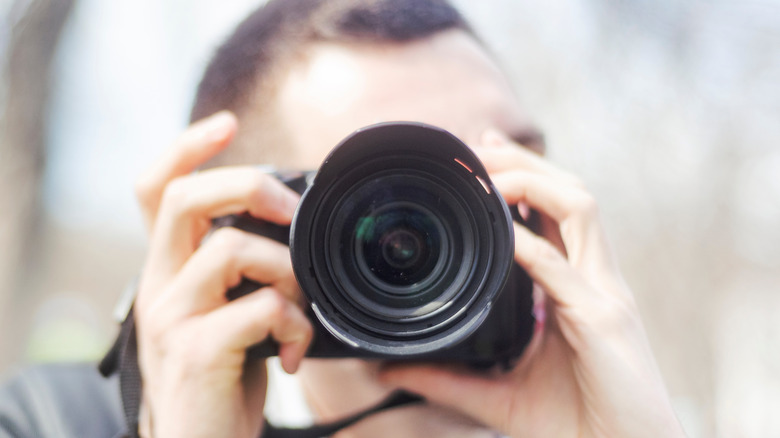 Man aiming a camera