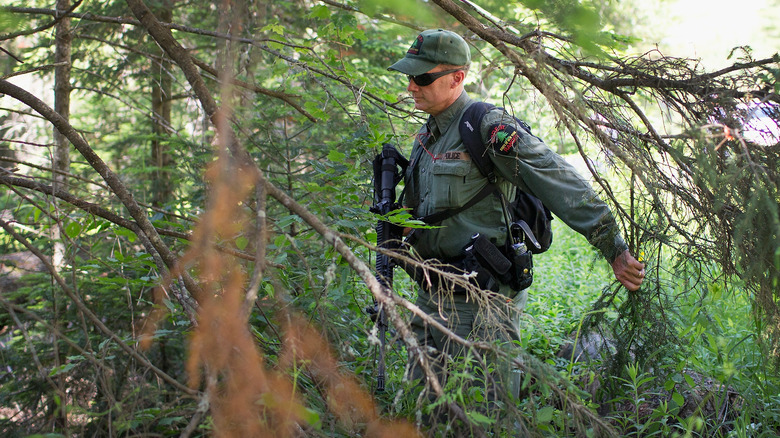 Police officer searching woods