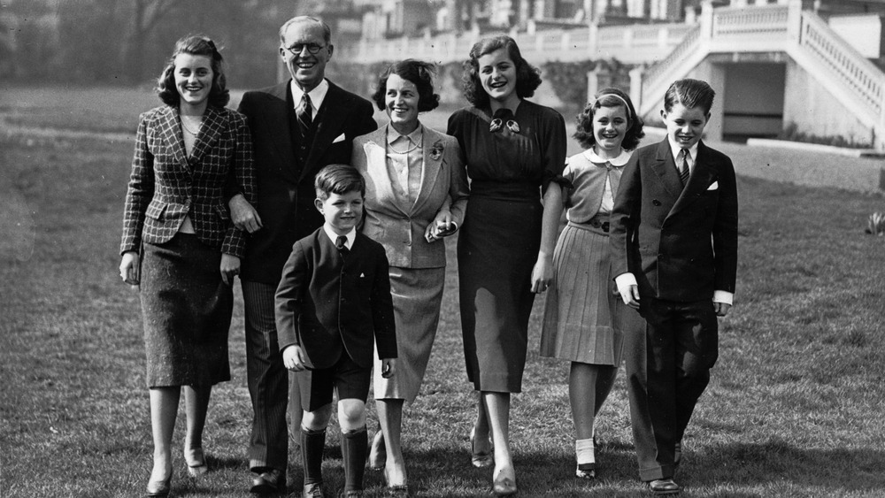 Group shot of Kennedy family smiling and walking
