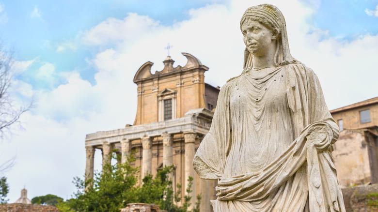 Vestal Virgin statue Roman ruin in background