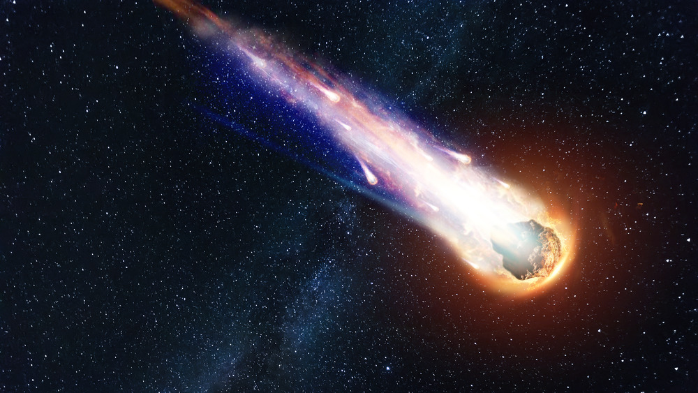 Meteorite hurtling through starry sky