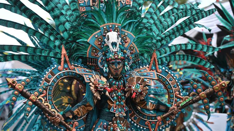Man wearing traditional Aztec regalia