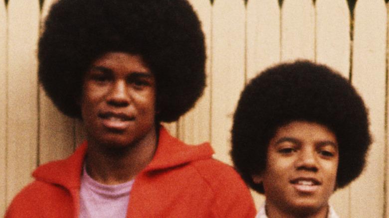 Jermaine and Michael Jackson posing