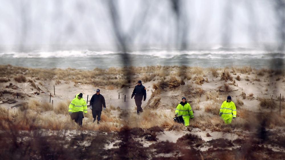 Investigators searching beach