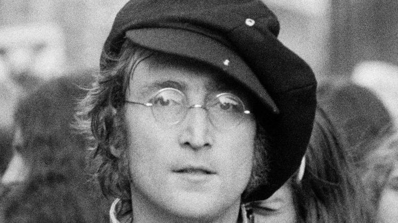 John Lennon wearing hat