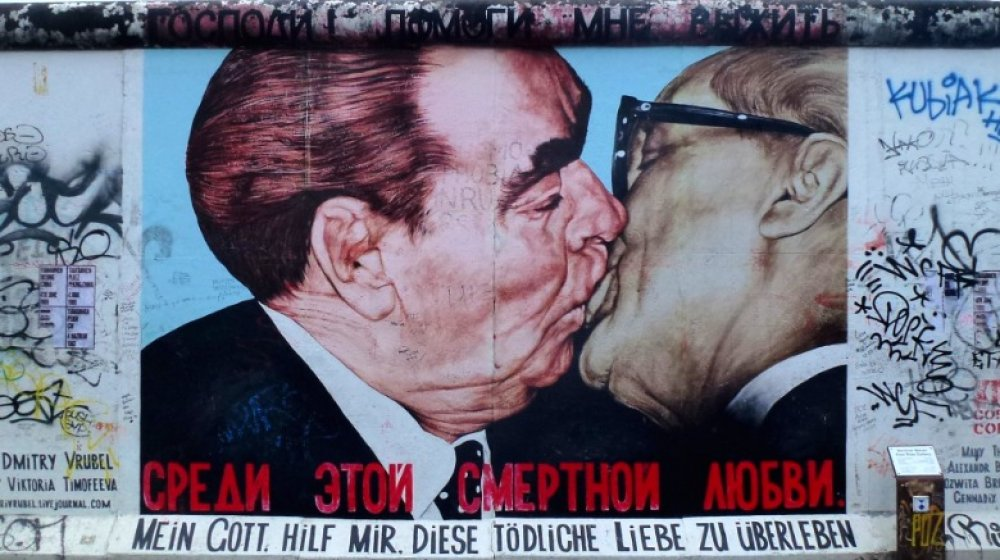 God Help Me Survive This Deadly Love graffiti on Berlin Wall