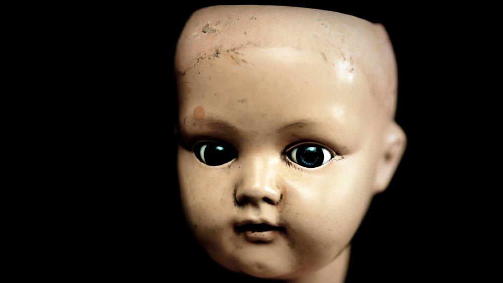 Creepy porcelain doll face