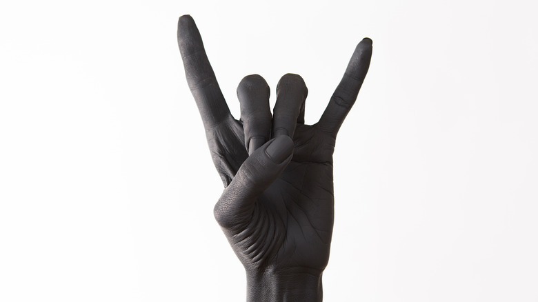 a hand in rock n roll devil horns position