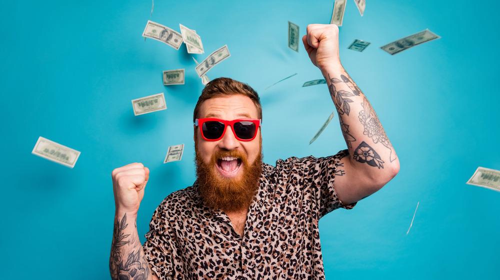 Man celebrating winning the lottery