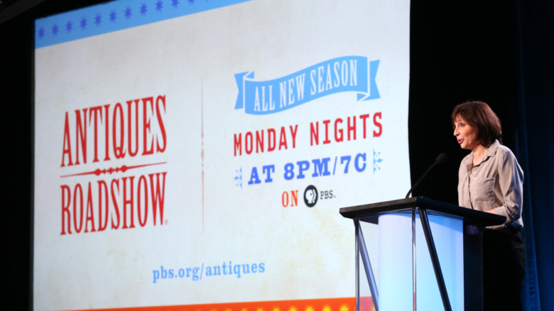Presentation slide with Antiques Roadshow logo for PBS with a woman talking on a podium