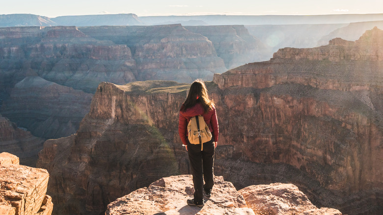 Hiker standing on the edge of the Grand Canyon