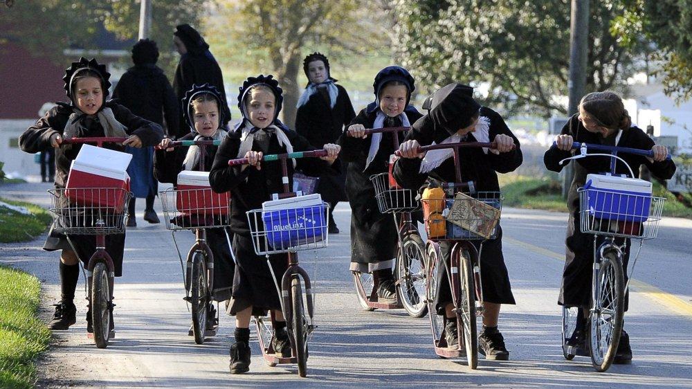 Amish girls riding bikes