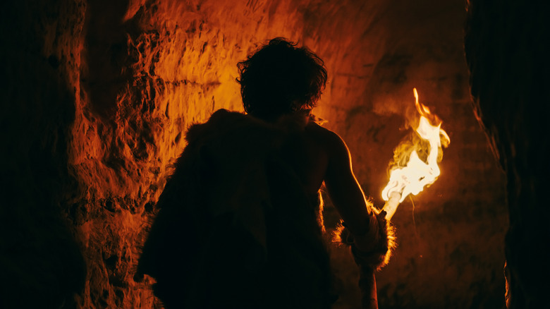 caveman holding a torch