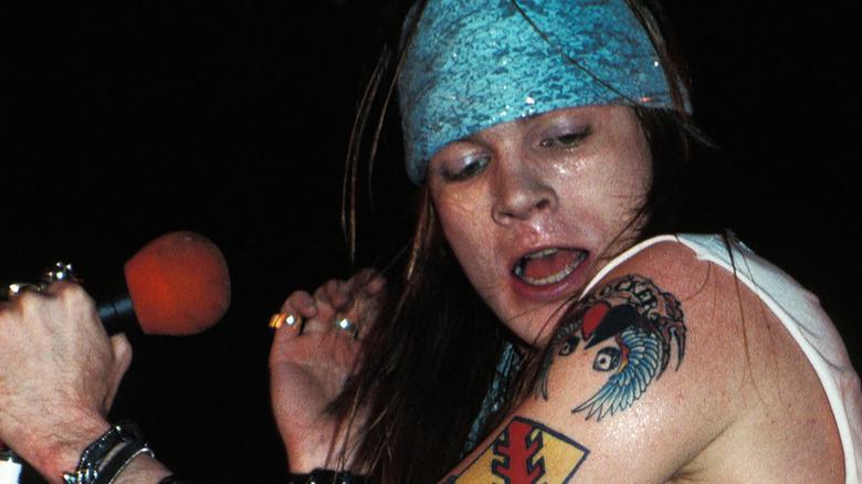 Axl Rose singing onstage