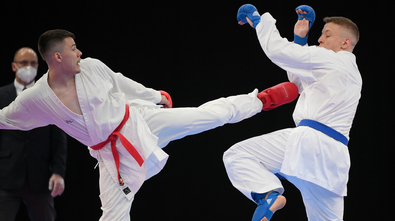 Marcel Shepelev (red) fights Maximilian Spisal (blue) in karate competition