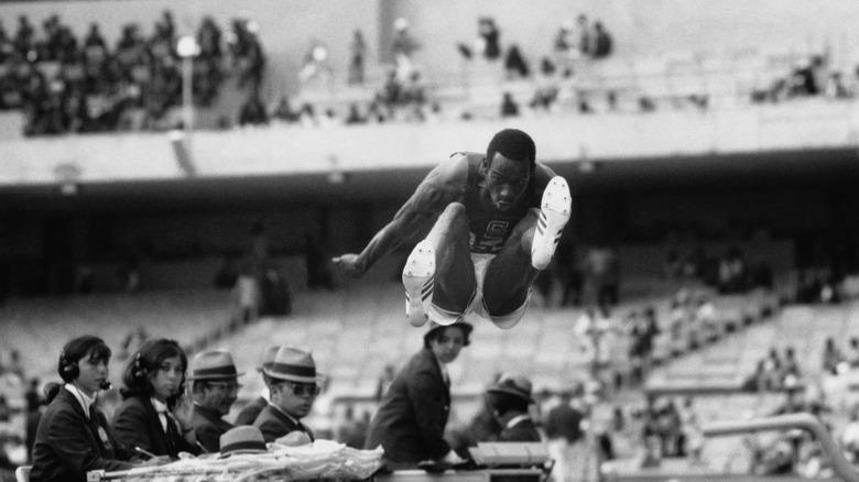 Bob Beamon setting an Olympic record in 1968