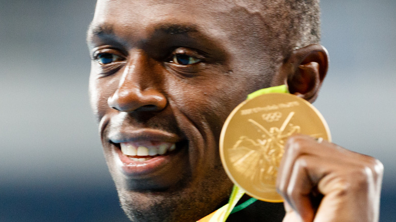 Usain Bolt with gold Olympic medal
