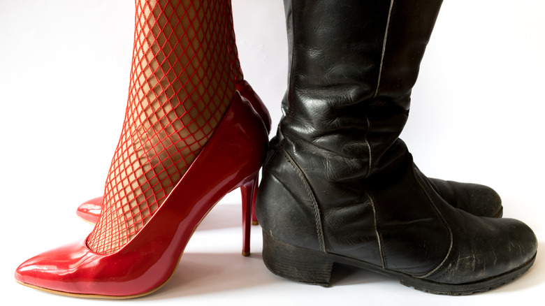 woman in high heels man in boots