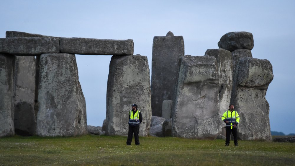 People standing before Stonehenge