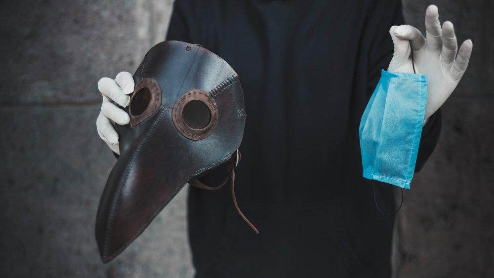 a plague mask and a modern mask
