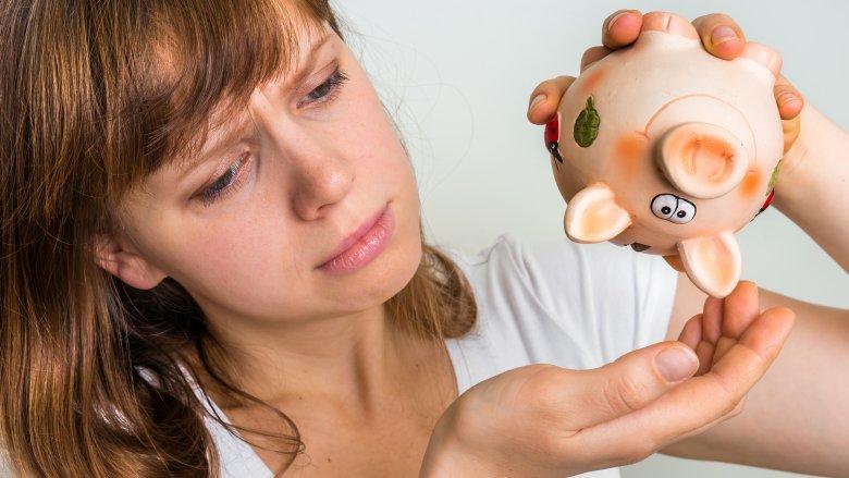 woman, piggy bank