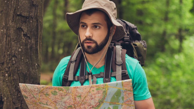 confused man, map, woods
