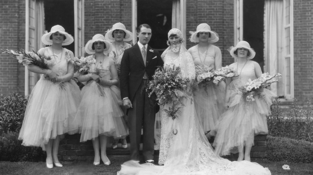 Bride surrounded by bridesmaids