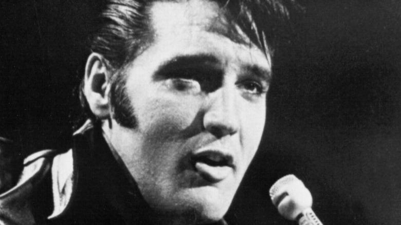 Elvis Presley singing into a microphone