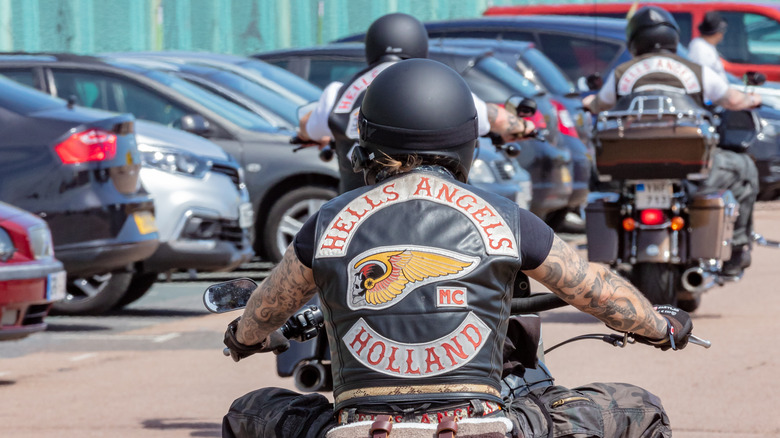 Hells Angel biker riding motorcycle