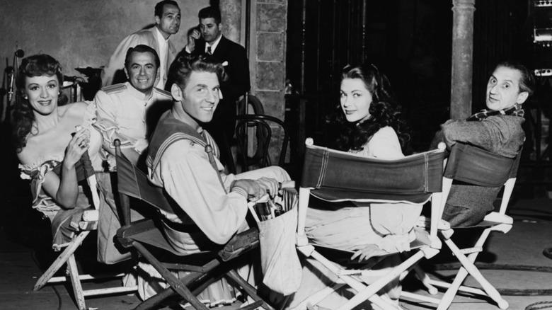 Eve Arden, Charles Kullman, Jean Aumont, Yvonne de Carlo, and Walter Reisch seated on film set
