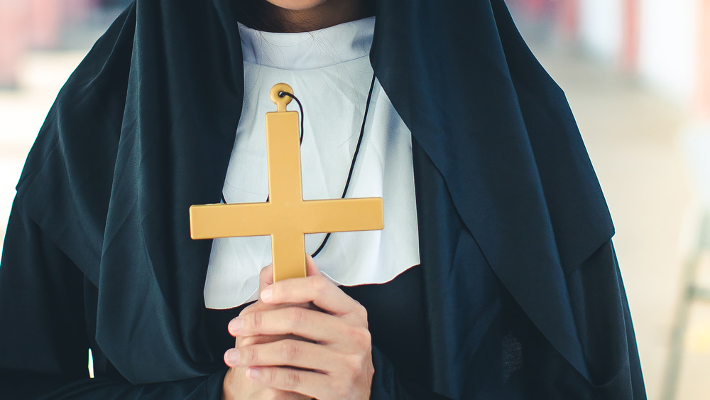 Nun holding a cross