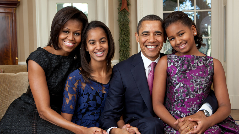 Official portrait by Pete Souza of the Obama family in the Oval Office.
